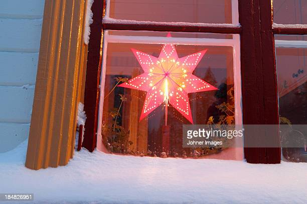 Christmas star decoration in window of house