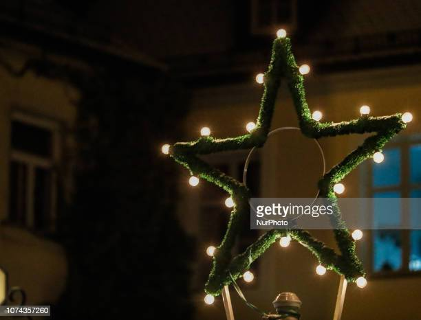 A christmas star with lights Christmas Market in the Northern Bavarian town of Ansbach