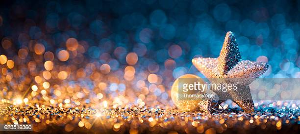 christmas star with ornament on glitter - bokeh defocused gold - christmas star stock photos and pictures
