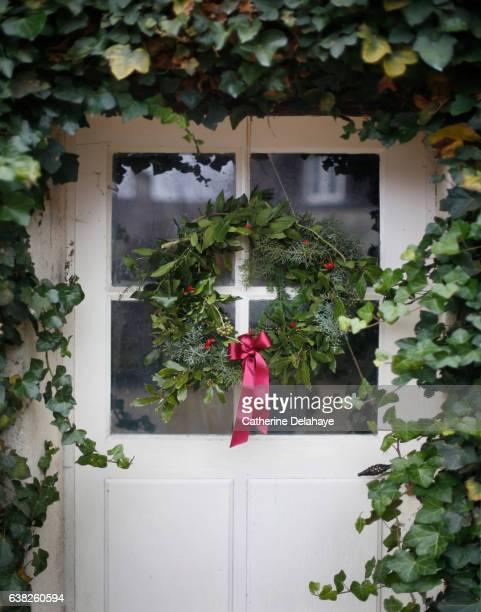 Christmas still life, a crown on a door