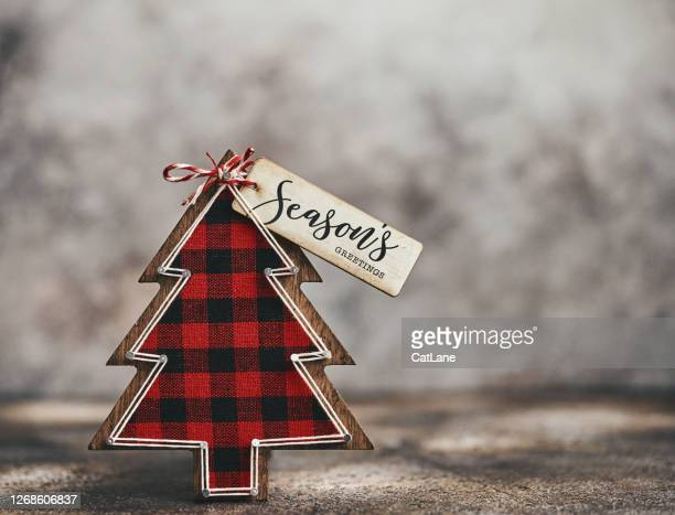 christmas still life with plaid christmas tree and greeting - checked pattern stock pictures, royalty-free photos & images