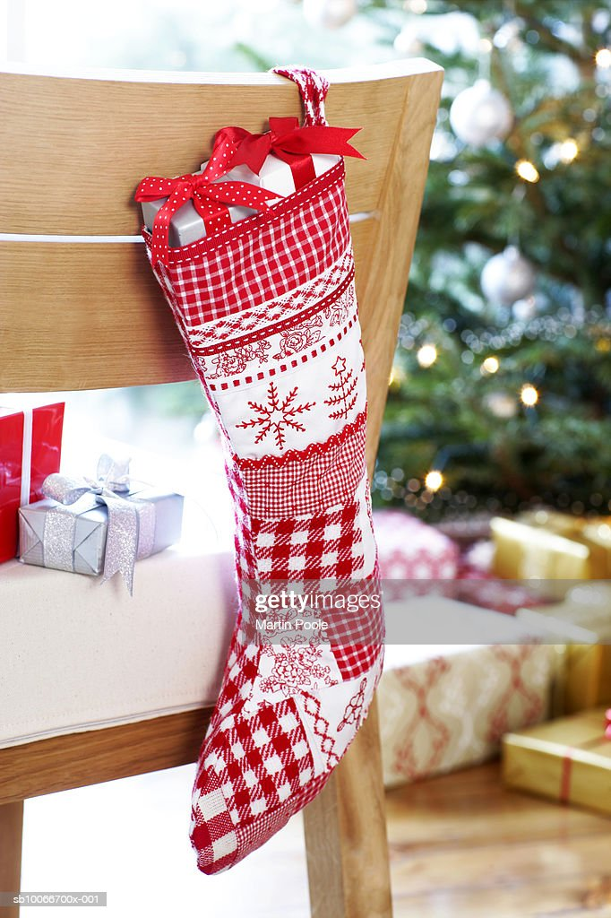 Christmas Stocking Hanging On Back Of Dining Room Chair : Stock Photo