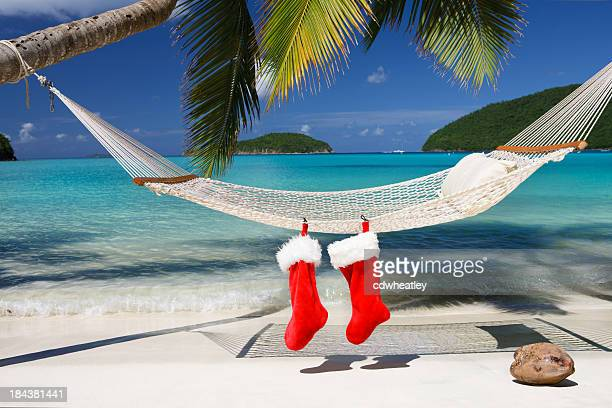 christmas stocking on a hammock at the tropical caribbean beach - beach christmas stock pictures, royalty-free photos & images