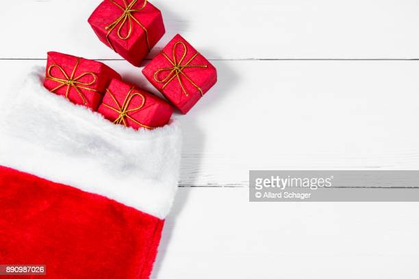 christmas stocking with presents rolling out - calza della befana foto e immagini stock