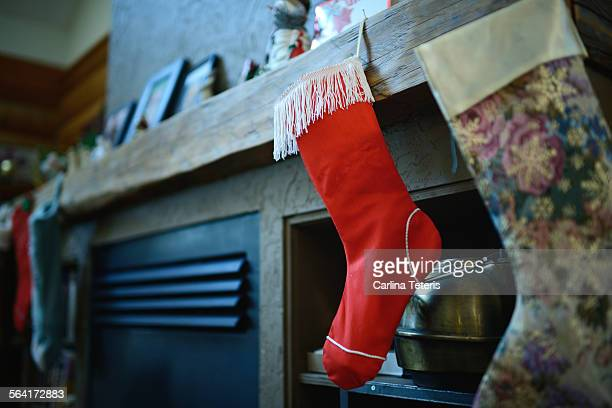 Christmas stockings in front of a fire place