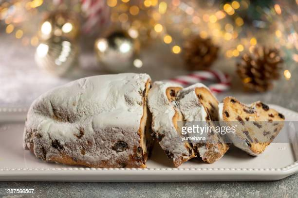 christmas stollen on wooden background. - german culture stock pictures, royalty-free photos & images