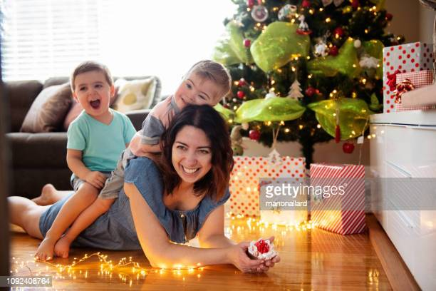christmas summer with single mother and her sons - hot mom stock photos and pictures