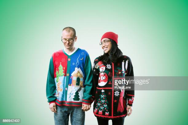 christmas sweater couple - jumper stock pictures, royalty-free photos & images