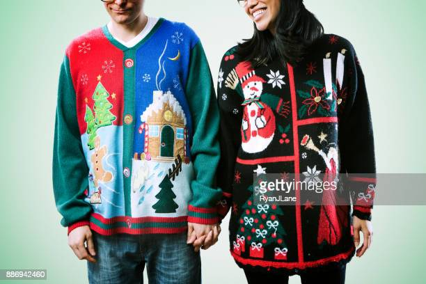 christmas sweater couple - sweater stock pictures, royalty-free photos & images