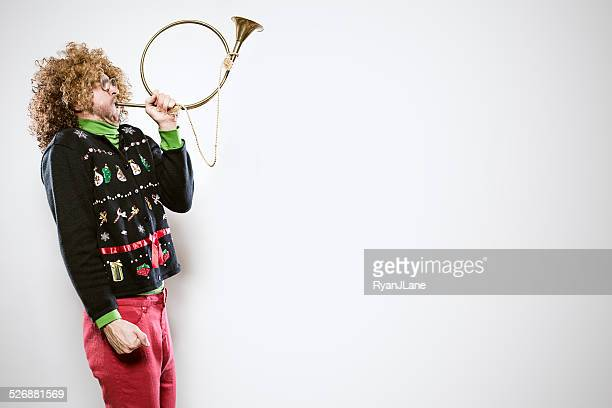 christmas sweater man with trumpet - sweater stock pictures, royalty-free photos & images