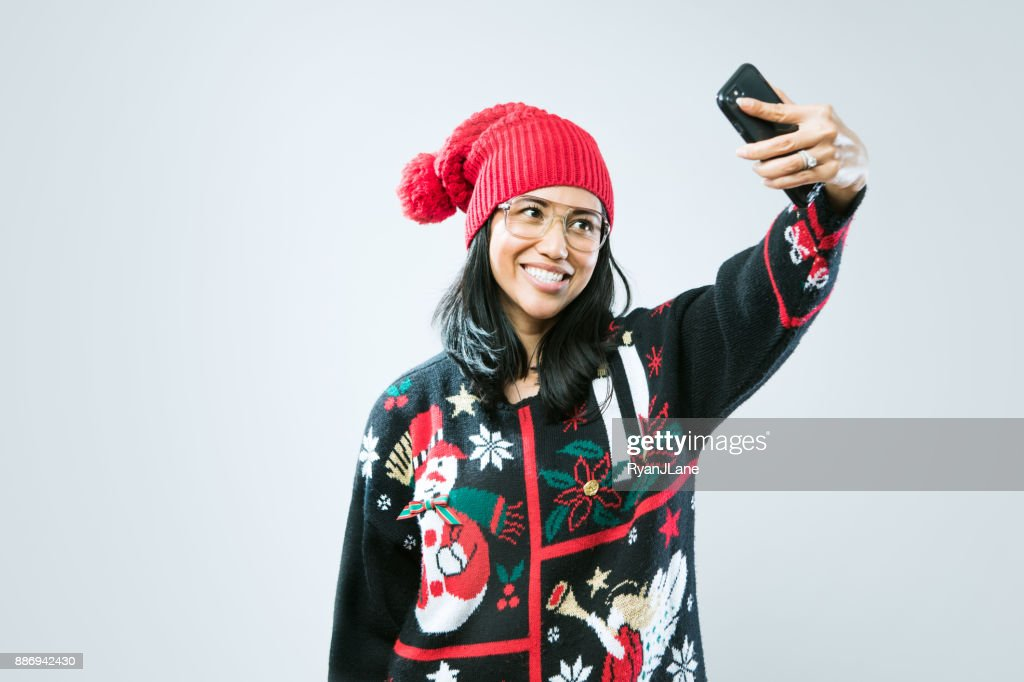 Christmas Sweater Woman Taking Selfie : Stock Photo