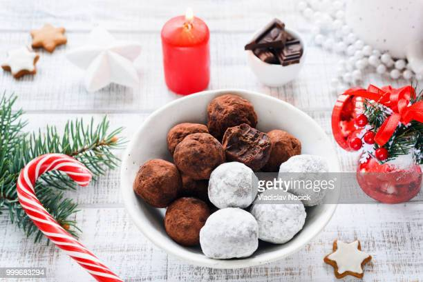 Christmas sweets chocolate truffles and Christmas chocolate candies on white table.