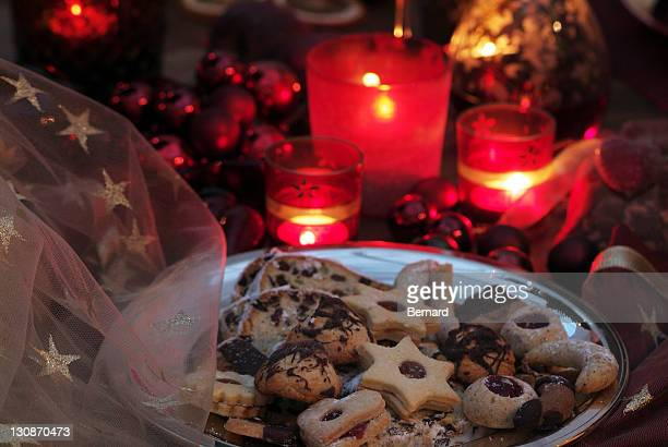 Christmas table decorations with Christmas cookies and atmospheric lighting
