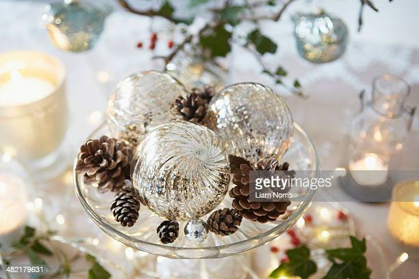 Christmas table with fir cones and glass baubles