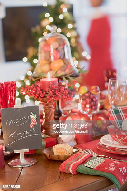 Christmas table, woman in background (USA)