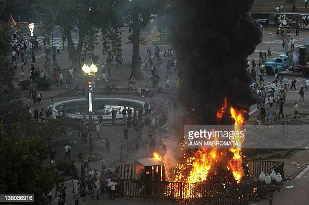 A Christmas three is burnt at Plaza de Mayo square in Buenos Aires on December 20 during a demo for the 10th Anniversary of the clashes of December...