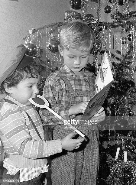 young boys beneath the christmas tree erarly fifties