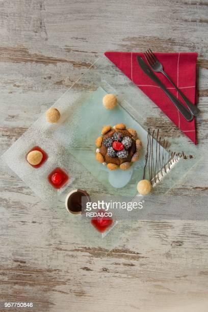 Christmas Tiramisu dessert with Baileys liqueur Mulberry candied cherries ganache of dark chocolate and amaretto elderberry