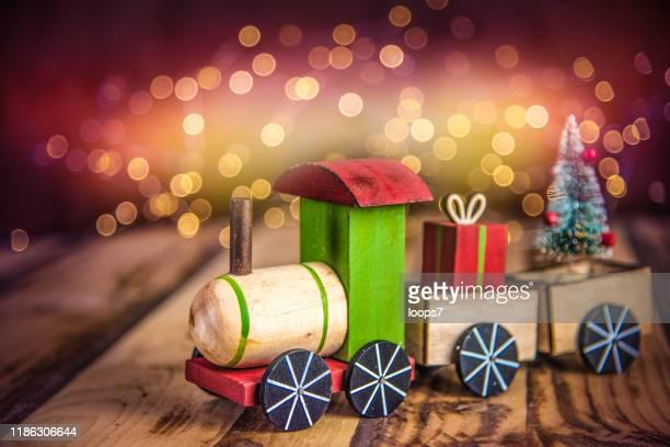weihnachtsspielzeug zug - monat stock-fotos und bilder