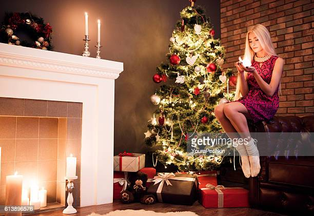 Christmas tree, a girl with candle, golden hair
