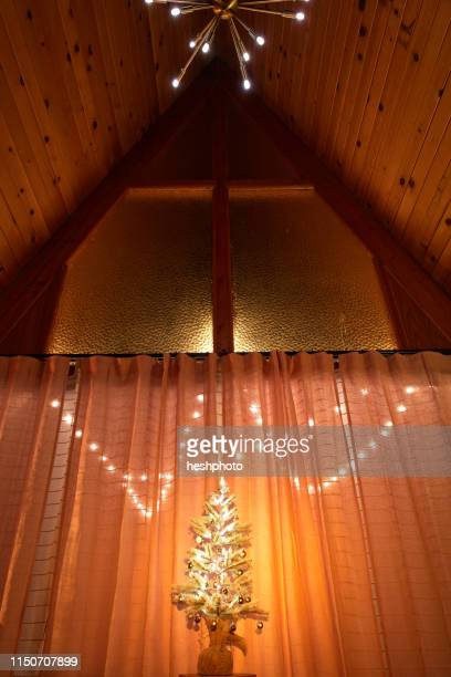 christmas tree and decoration in a-frame house - heshphoto stock pictures, royalty-free photos & images