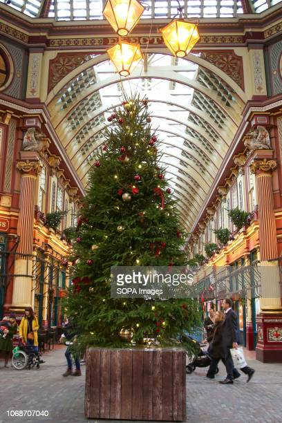 Christmas tree and decorations seen at the centre of Leadenhall Market. Leadenhall Market is one of the oldest market in the London, dating back to...