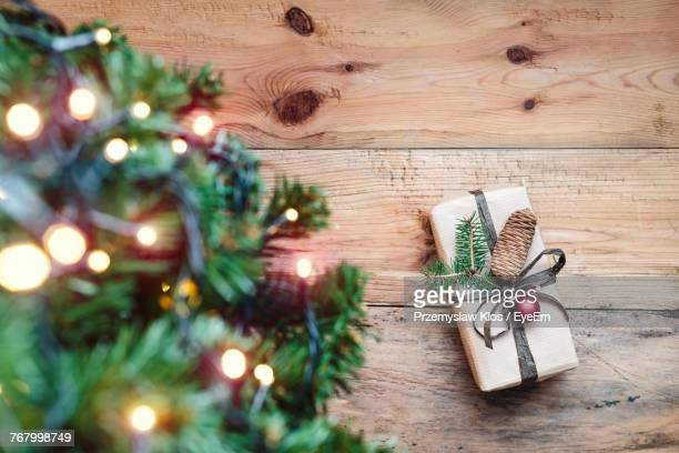 Christmas Tree And Gift On Wooden Table