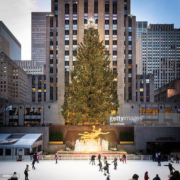 christmas tree and ice rink at rockefeller center - rockefeller center stock pictures, royalty-free photos & images