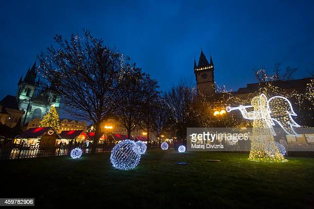 Christmas tree and illuminated angel stand at the Christmas market at the Old Town Square on December 1 2014 in Prague Czech Republic Christmas...
