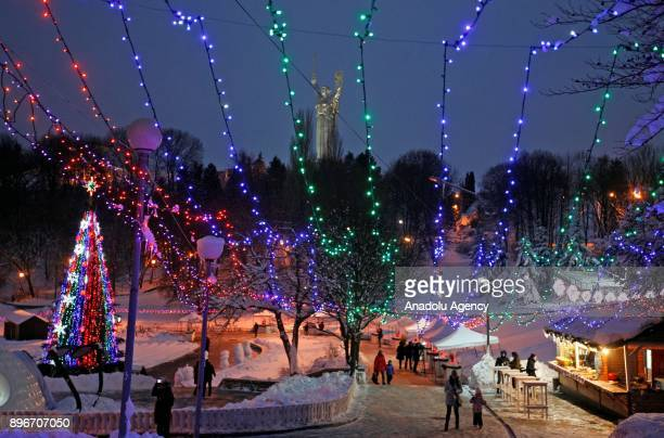 Christmas tree and illuminated area are seen during the New Year's festival 'Ice Age' on the Pevcheskoye Field in Kiev Ukraine on December 21 2017...