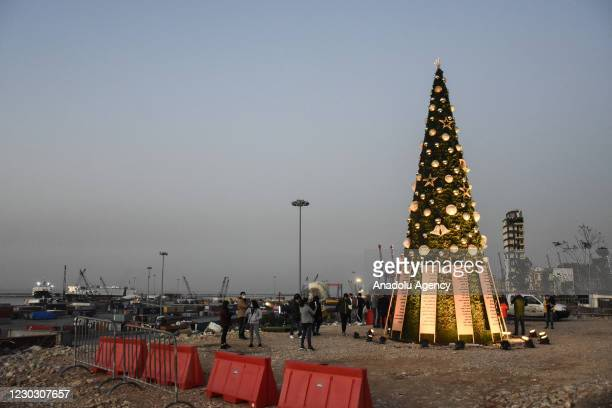 Christmas tree, and lists of victims who died in massive explosion at Beirut Port, is placed at the explosion site to commemorate during the...