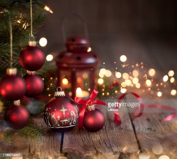 christmas tree and nativity ornaments on an old wood background picture