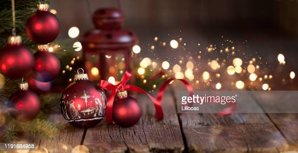 christmas tree and nativity ornaments on an old wood background - christmas banner stock photos and pictures