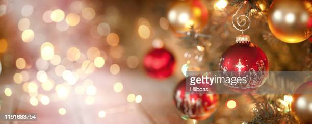 christmas tree and nativity ornaments with defocused lights background - nativity scene stock pictures, royalty-free photos & images