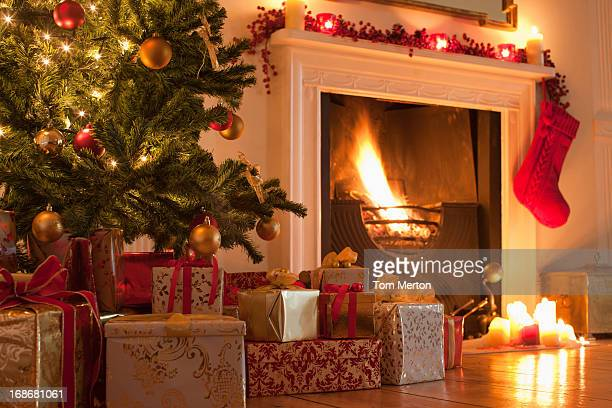 christmas tree and stocking near fireplace - christmas stocking stock photos and pictures