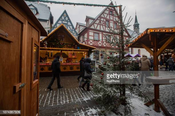 Christmas tree and view on the christmas market Christmas Market in the Northern Bavarian town of Forchheim It snowed heavily but a lot of people...
