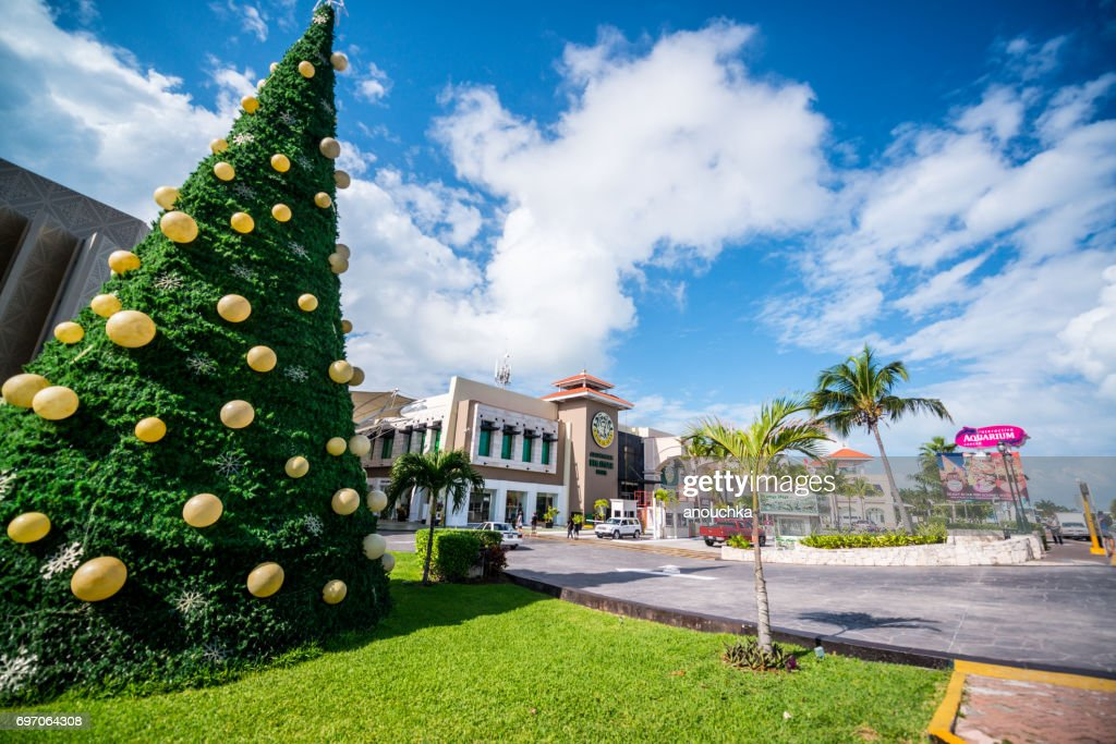 christmas tree at the entrance to la isla shopping village in cancun mexico stock