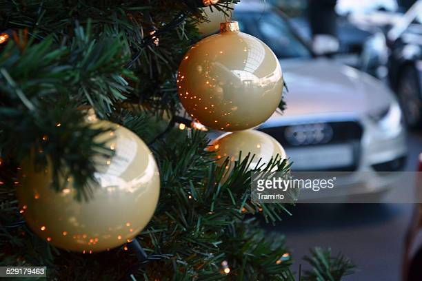 Christmas tree, baubles and a luxury car