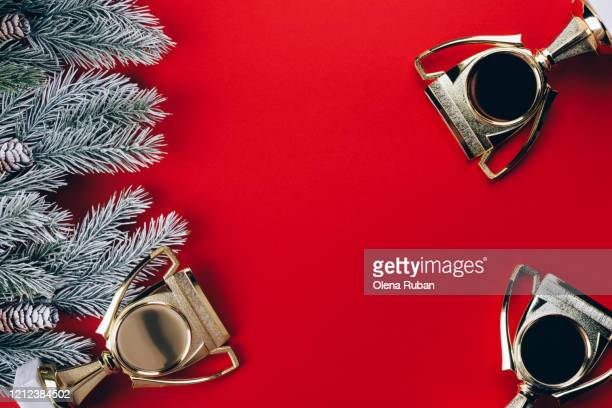 christmas tree branches and a winner's cup - competition stock pictures, royalty-free photos & images