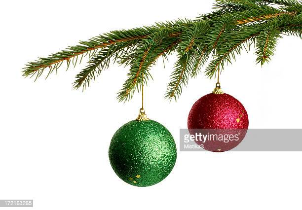 Christmas tree branches holding two decorative balls