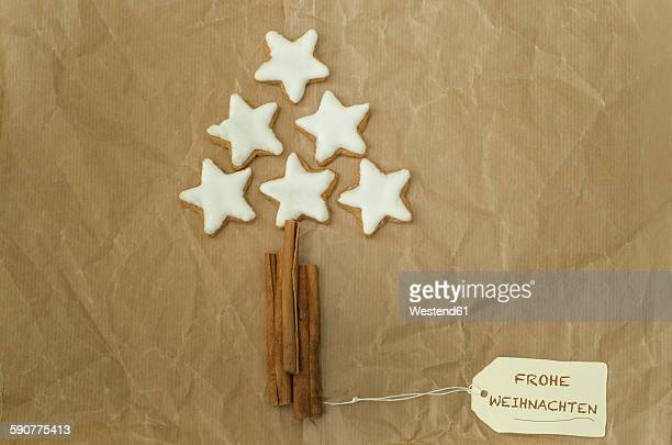 Christmas tree built of cinnamon stars and sticks on packing paper