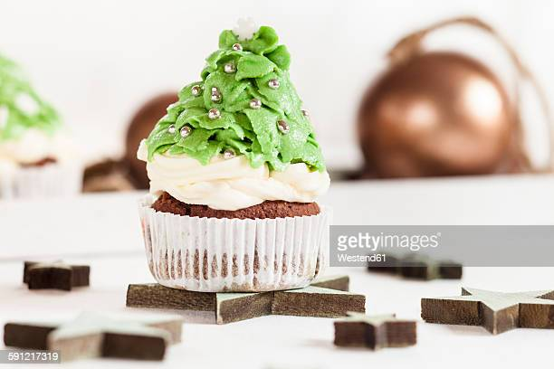 Christmas tree cup cakes and Christmas decoration on festive table