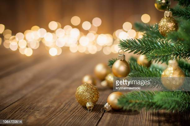 christmas tree decorated with christmas balls on rustic wood and sparkles light backgorund - christmas wallpaper stock pictures, royalty-free photos & images