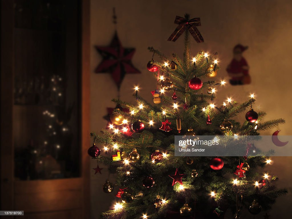 Christmas Tree Decorated With Lights At Night Stock Photo