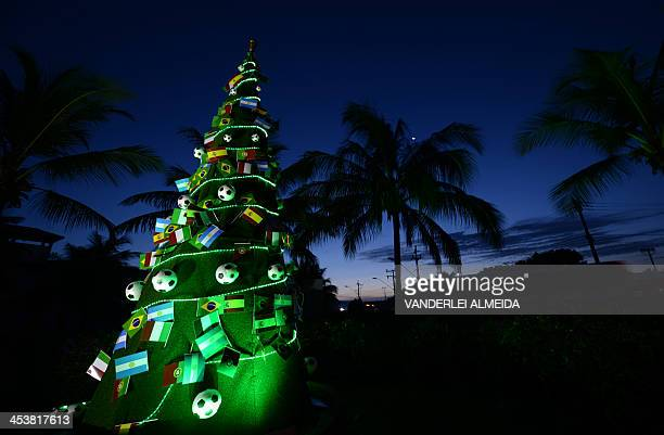 A Christmas tree decorated with soccer balls and flags is seen as the sun goes down on the eve of the Brazil 2014 FIFA Football World Cup final draw...