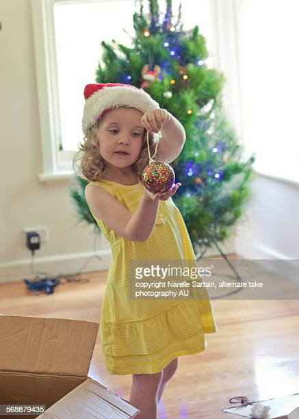 Christmas tree decorating by young girl