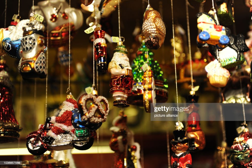 christmas tree decorations are for sale at a merchants booth at the munich christmas market in - Christmas Tree Decorations Sale