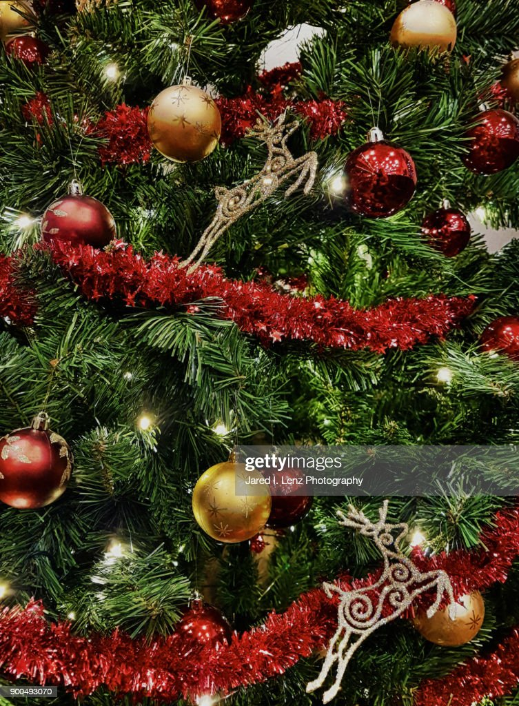 christmas tree decorations in red gold stock photo