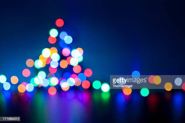 christmas tree - defocused lights blue multicolored - illuminate stock photos and pictures