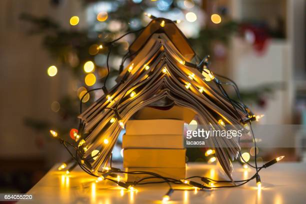 christmas tree formed with books and christmas lights